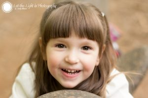 Brown eyed girl looking up at tha camera. Taken by Natural Light Portrait Photographer in Prince William County VA