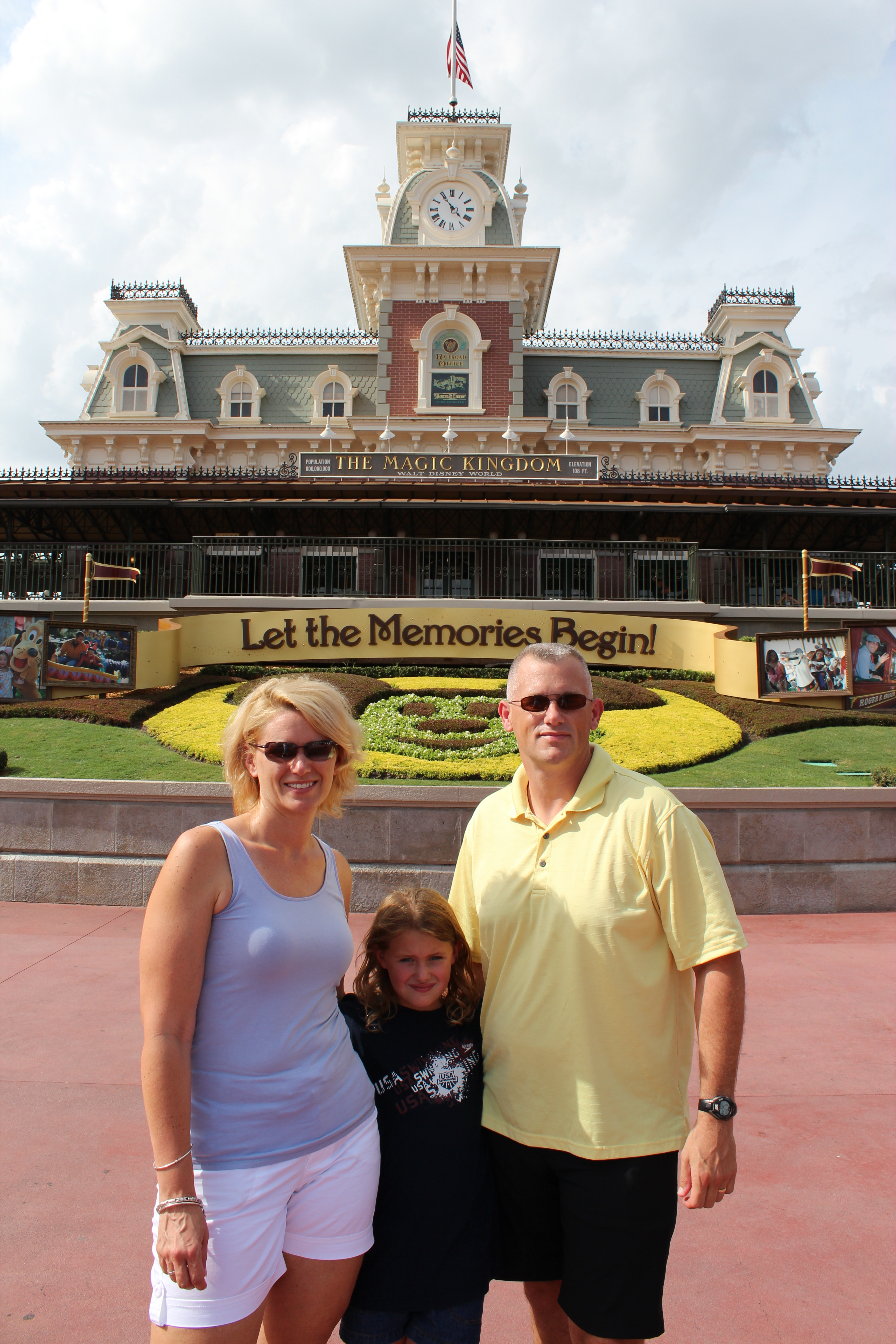 Family Photo at the entrance to the Magic Kingdom at Disney World.  From Let the Light in Photography's Blog