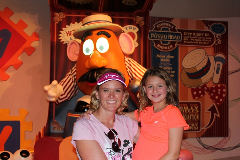Mom and Child in front of Mr. Potato Head at Disney.  From Let the Light in Photography's Blog