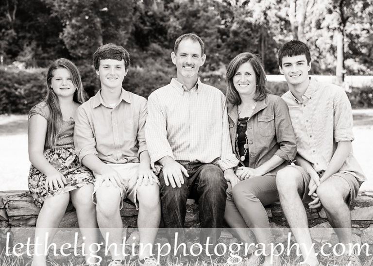 Family of 5 sitting on a stone wall at Chapman's Mill near Haymarket VA