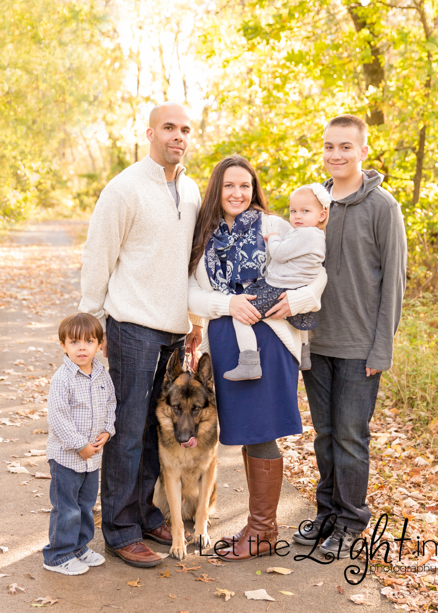 Family Of 5 With Dog Poses On A Path In Bristow VA For Portrait Picture