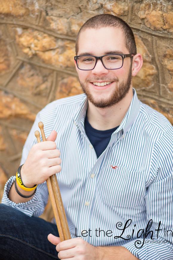 Senior High School Guy with drumsticks posing for Senior Portraits in Warrenton VA