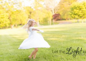 Girl twirling in her First Communion Dress