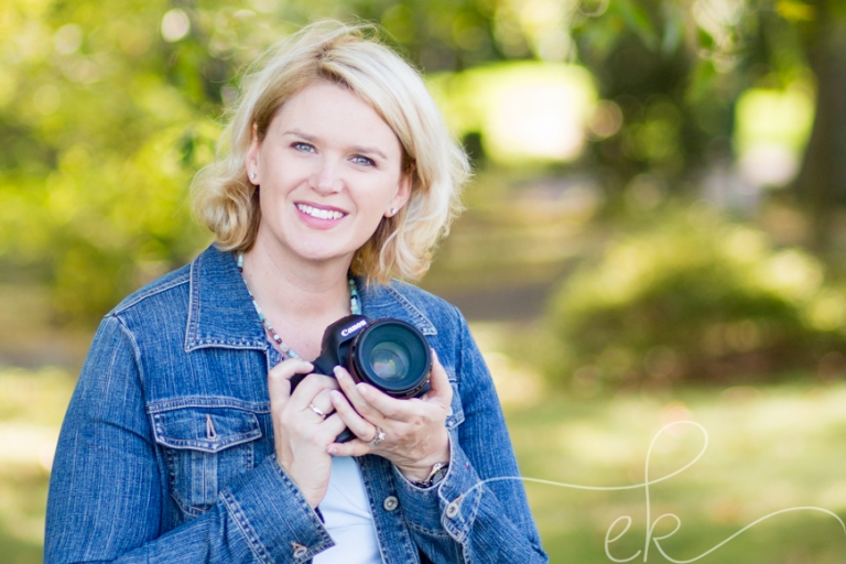 Local Photographer near Bristow VA posing with camera for headshot