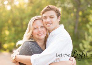 Senior hugging his mom for a portrait