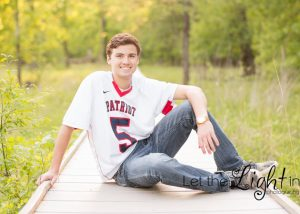 High School Senior posing for a portrait in Lacrosse Jersey from Patriot High School in Bristow Virginia VA 20136
