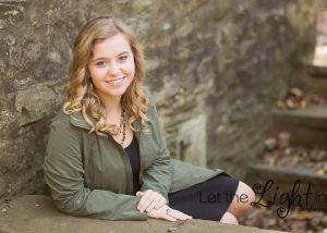 High School Senior Picture of girl sitting on steps at a winery outside of Gainesville VA