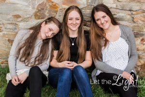 sisters portraits sitting against a wall at Chapman's Mill outside of Haymarket Virginia