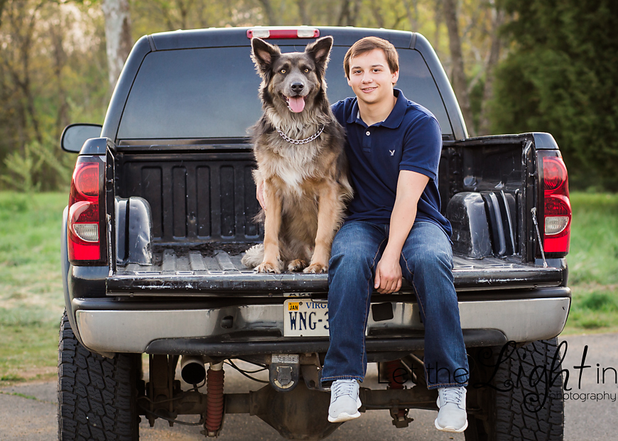 High School Senior Guy sitting on his truck with his dog