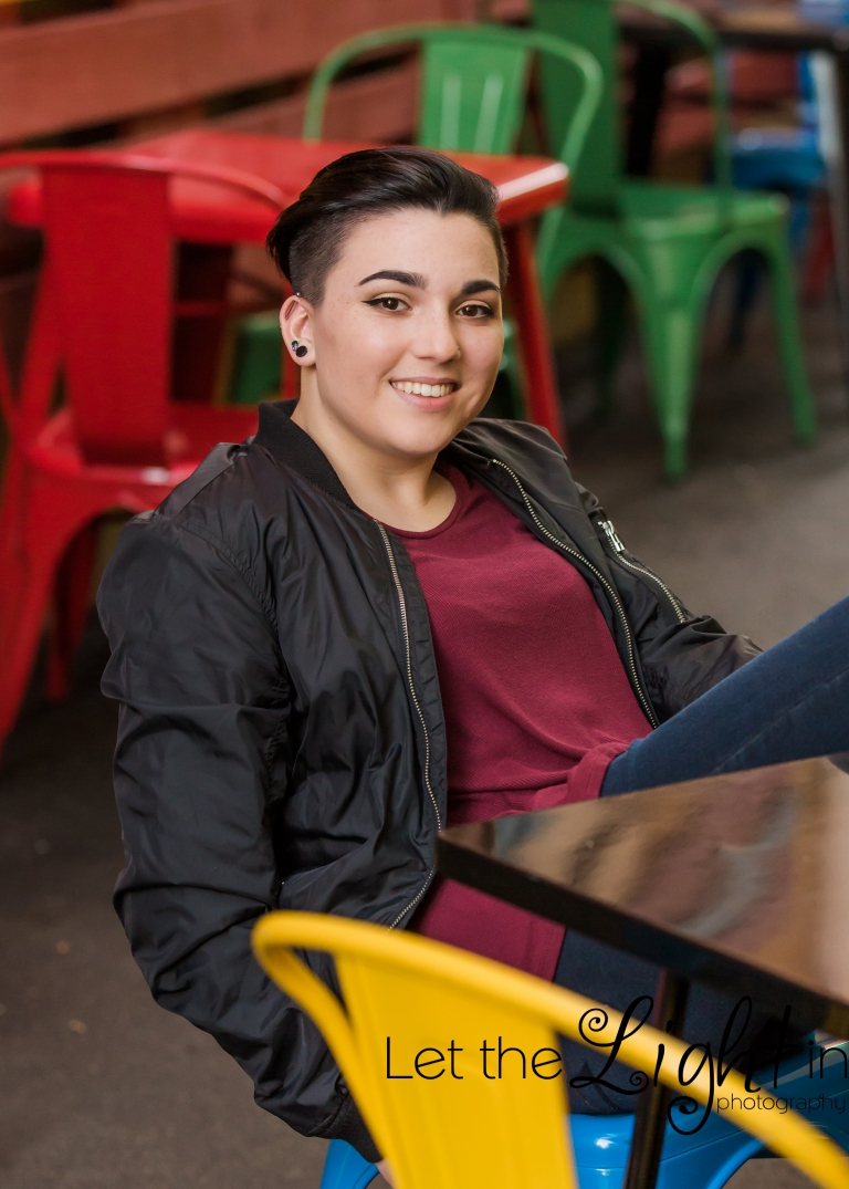 Unique Senior Portraits in a cafe in Old Town Manassas with lots of colorful chairs