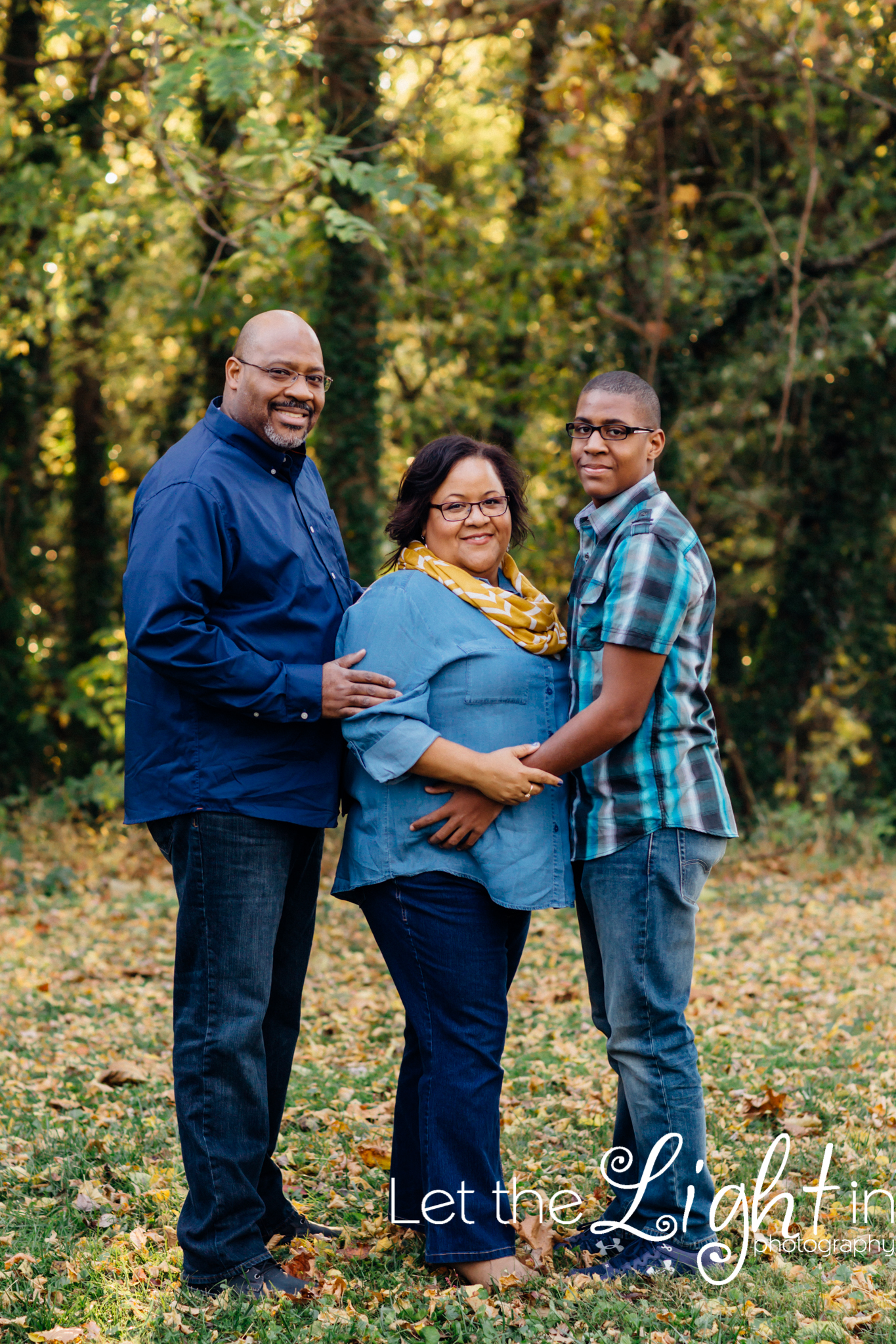 Family of 3 posing for fall portraits