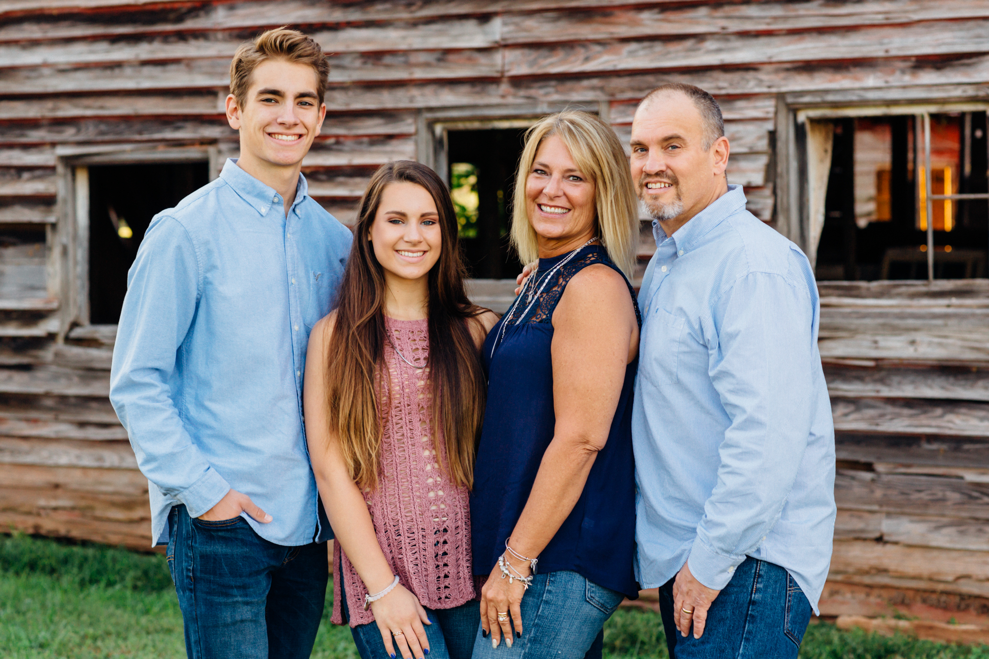 Family posing for family portrait, they have a high school senior