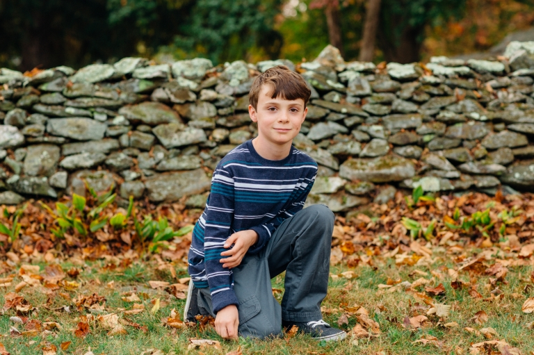 boy kneeling and posing for a portrait at a local venue in Warrenton Virginia