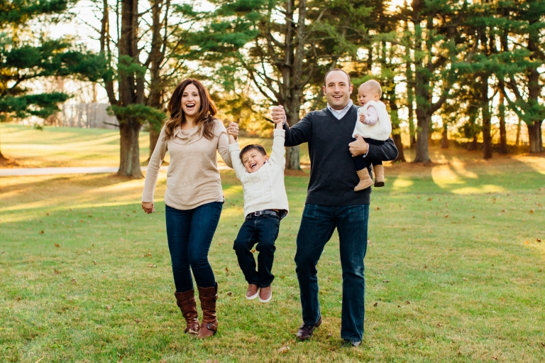 family of 4 swinging their son