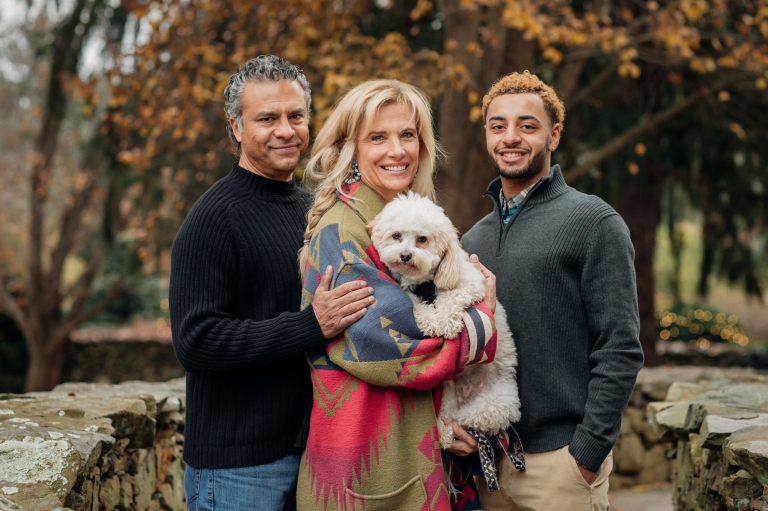 Family of 3 with a High School Senior Son, posing for family portraits with their dog