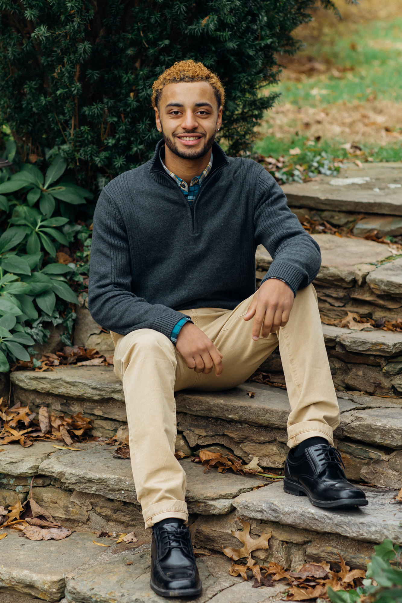 Haymarket VA High School Senior sitting on stone steps posing for portrait