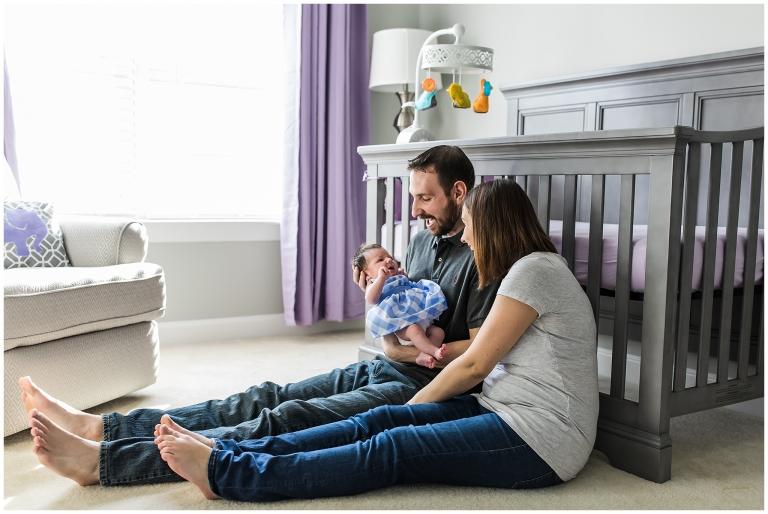 New parent adoring newborn baby girl