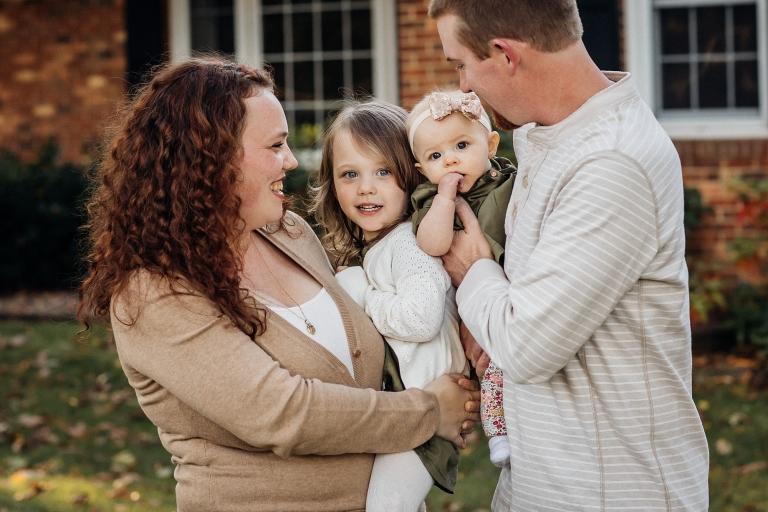 family of 4 hugging for family portrait