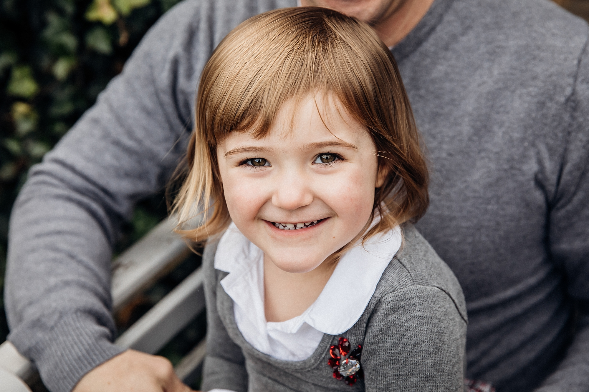 3 year old girl looking at camera with big eyes