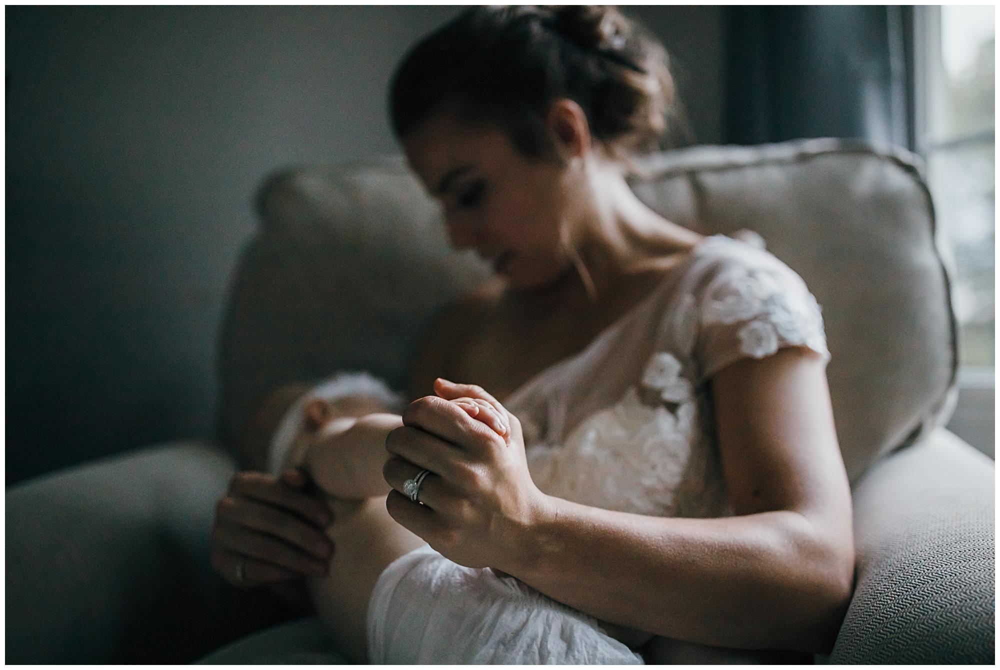 bride nursing her daughter