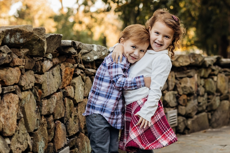 brother and sister hugging for family photographer