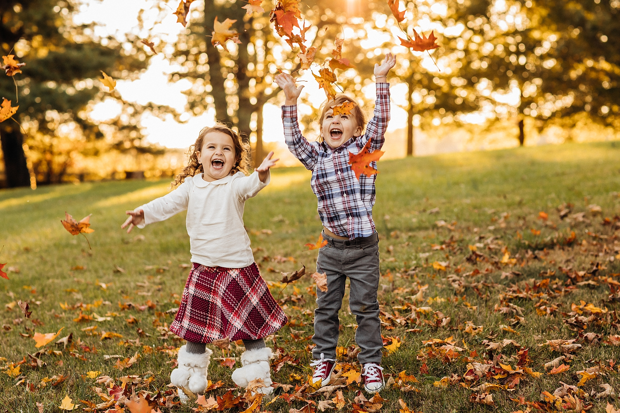 siblings throwing leaves
