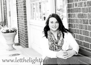 Black and white on location portrait of High School Senior taken in Old Town Manassas