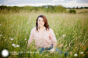 Portrait of a high school senior girl in a field of flowers at the Manassas Battlefield in Virginia