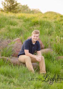 Boy Sitting on rocks at Camp Snyder in Haymarket