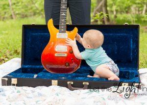 baby sitting in dad's guitar case near the stone bridge at Manassas Battlefield.