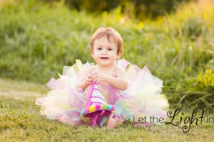 1 year old girl with tutu and birthday hat