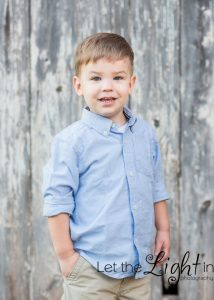 3 year old boy posing for family portraits near Gainesville Va