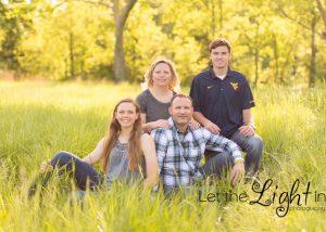 Family sitting in the grass at Manassas Battlefield in Virginia