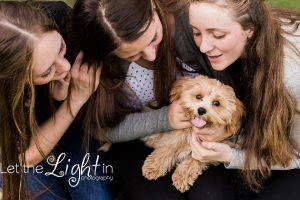 Sisters with family dog. Family Photographer in Haymarket Virginia VA